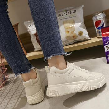 艾微妮韩版学院风系带平底小白鞋