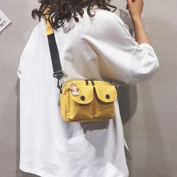 萨兰丹迪ins风双兜轻便布包单肩包实用包包送挂件随机